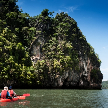Kayaking exploring Rock island of Koh Talabeng near Koh Lanta, Krabi, Thailand